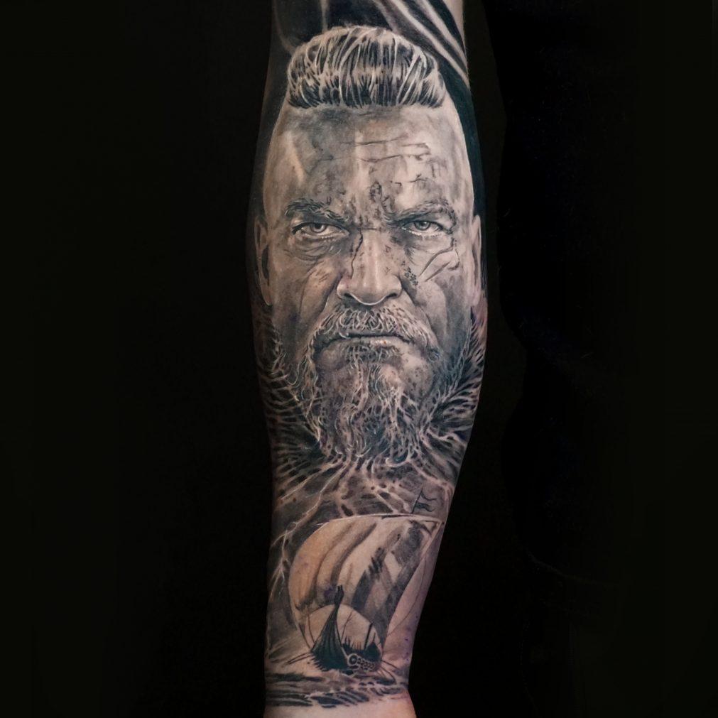 Black and Grey Realism Half Sleeve Tattoo of a Fierce Viking Warrior by Alo Loco