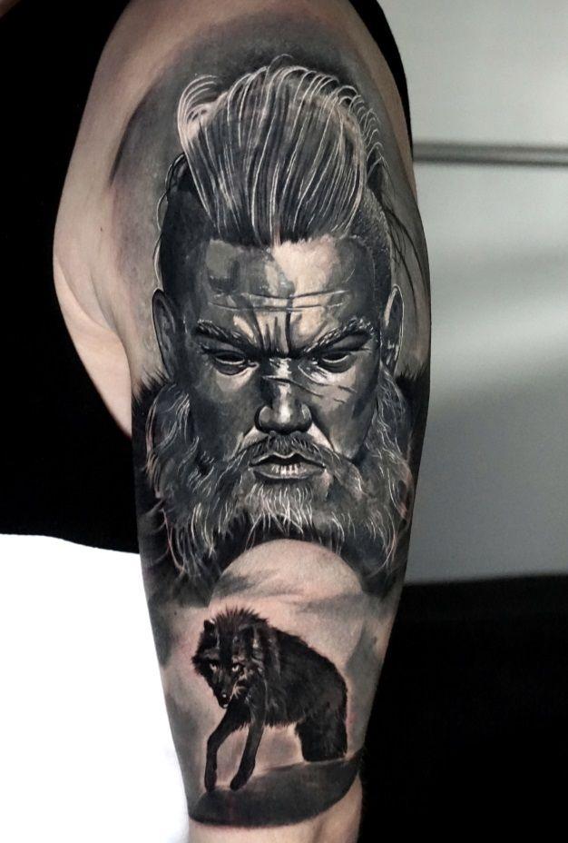 Black and grey sleeve tattoo of Viking warrior berserker portrait and Fenrir wolf by Alo Loco, London best tattoo artist, top UK
