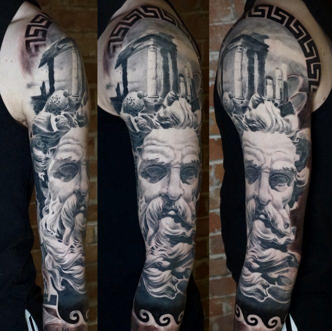 Arm sleeve tattoo in black and grey realistic Poseidon, Neptune Greek Roman mythology by Alo Loco, London tattoo artist, UK