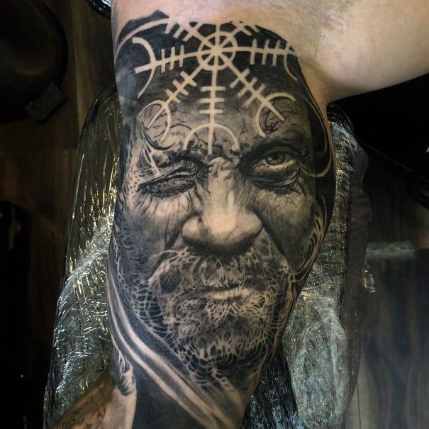 Black and grey realistic portrait arm tattoo of Viking Odin God by Alo Loco, best London tattoo artist, top UK